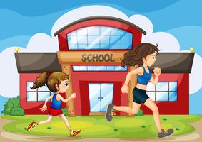 Ein Kind und eine Frau laufen vor der Schule