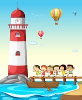 Kinder und Leuchtturm vektor