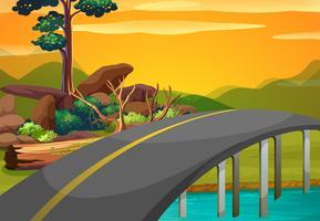 Szene mit Brücke über den Fluss bei Sonnenuntergang