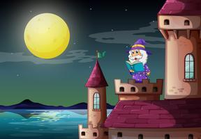 En slotthamn med en trollkarl som läser en bok