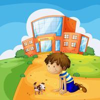 Ein kleiner Junge und sein Haustier in der Nähe der Schule