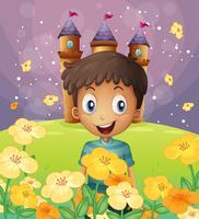 Ein fröhlicher Junge vor dem Schloss auf dem Hügel vektor