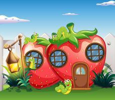 Erdbeerhaus mit Gleiskettenfahrzeugen im Garten