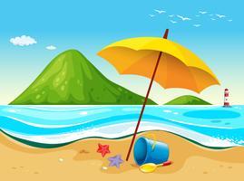 Strandszene mit Regenschirm und Spielzeug vektor