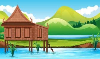 Thai stil hus i vattnet