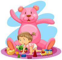 Kleines Mädchen mit rosafarbenem Bären und Spielwaren