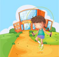 Ein Mädchen spielt in der Nähe der Schule