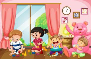 Vier Kinder, die im Wohnzimmer Spielzeug spielen
