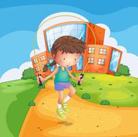 Ein junges Mädchen, das am Schulboden spielt