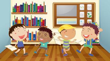 Pojkar läser böcker i klassrummet