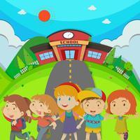 Barn står framför skolan vektor