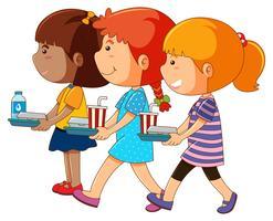 Tre tjejer med bricka av mat
