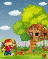 Pojke och hund springar i parken på regnig dag