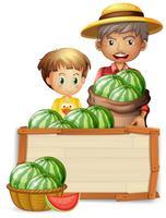 Landwirt, der Wassermelone auf Fahne hält