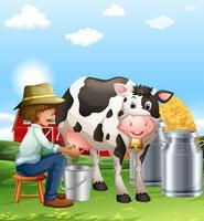Jordbrukaren mjölker en ko på dagtid