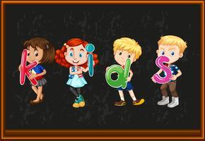 Barn med alfabeter på brädet