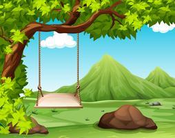 Naturszene mit Schwingen auf dem Baum vektor