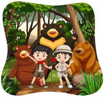 Barn och grizzlybjörnar i skogen vektor