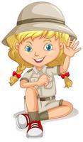Liten flicka i scoutuniform vektor
