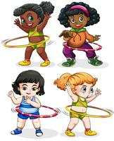 Vier Mädchen, die Hulahoops spielen