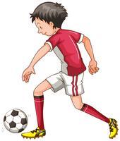 Man i röd outfit spelar fotboll