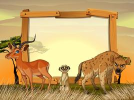 Ramdesign med vilda djur i fältet
