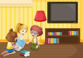 Tre barn arbetar på dator hemma