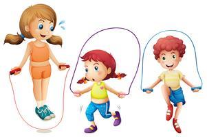 Tre barn hoppar rep på vit bakgrund