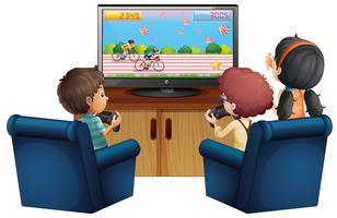 Tre barn spelar spel hemma