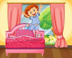 Liten tjej hoppar på sängen