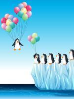 Pingviner på is och flygande med ballonger