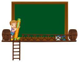 Brettschablone mit dem Jungen, der Zeichenstift hält