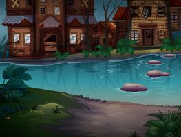Hus i dåligt tillstånd längs floden