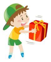 Liten pojke med presentförpackning