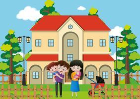 Familjen står framför huset