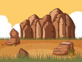 Scen med stenigt berg och fält