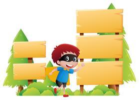 Trä skylt mall med pojke i hjälte kläder vektor