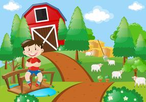 Junge, der auf dem Bauernhof lächelt