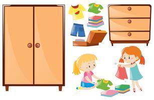 Set Mädchen, die Kleidung und Wandschränke falten vektor