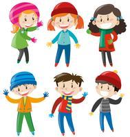 Pojkar och tjejer i vinterdräkt