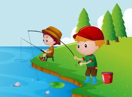 Två pojkar som fiskar vid floden