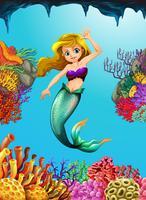 Hübsche Meerjungfrau, die unter Wasser schwimmt vektor