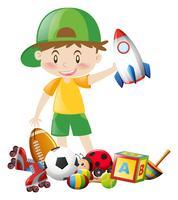 Liten pojke och många leksaker