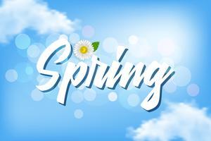 Aufschrift Frühling gegen einen blauen Himmel mit Wolken und Kamille