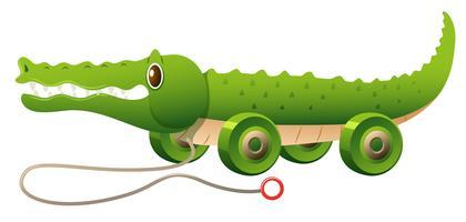 Spielzeugkrokodil mit Rädern vektor