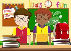 Två pojkar i klassrummet vektor