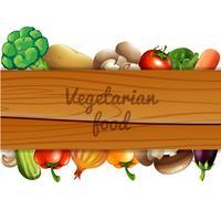 Många grönsaker och träskylt vektor