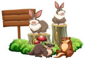 Kaniner och bäver vid skylten vektor