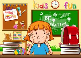 Tjej lär sig i klassrummet