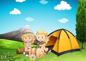 Pojke och tjej camping i parken vektor